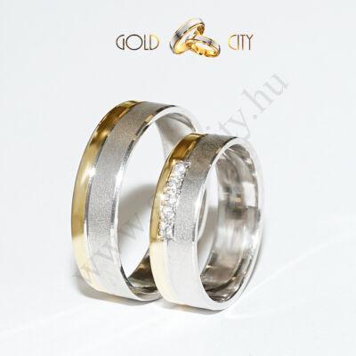 Karikagyűrű 14 karátos  sárga és fehér aranyból kövekkel-goldcity.hu