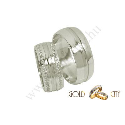 Széles fehér arany karikagyűrű, a hölgyek részére sok kővel.