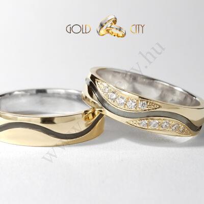 Sárga és fekete, 14 karátos arany karikagyűrű, mély hullám mintával