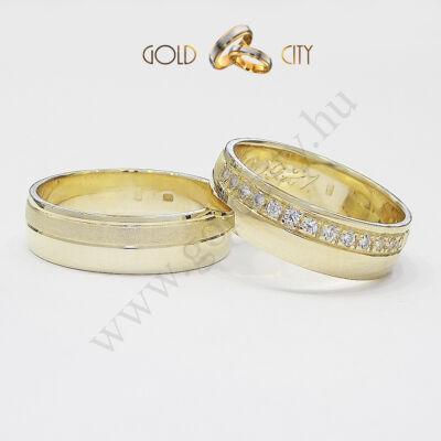 Sárga arany karikagyűrű, kövekkel díszítve a Gold City Ékszer Webáruház kínálatából.