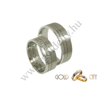 Modern, fehér arany karikagyűrű, a nőiben kövekkel.