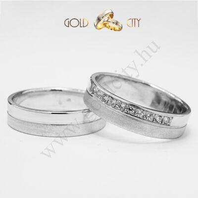 Modern karikagyűrű fehér aranyból, a női gyűrű kövekkel díszítve,