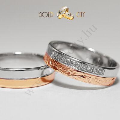 Szolidan elegáns kétszínű 14 karátos arany karikagyűrű, csillogóan kövekkel és kézi véséssel.