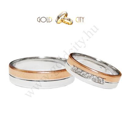 Kétszínű 14 K arany karikagyűrű a női változat kövekkel díszítve