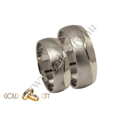 Modern, matt és fényes 14 karátos fehér arany karikagyűrű, a női gyűrű kövekkel díszítve.