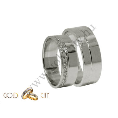 Modern, 14 karátos fehér arany karikagyűrű, a női változat sok-sok csillogó kővel díszítve.