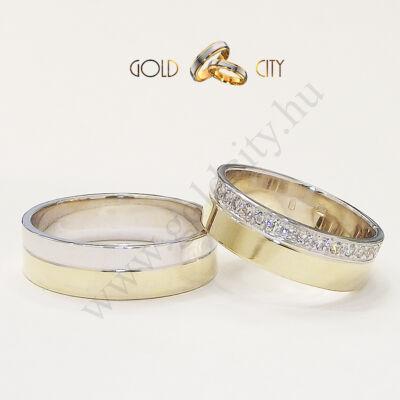 Modern kétszínű karikagyűrű, a női változat sok-sok csillogó kővel