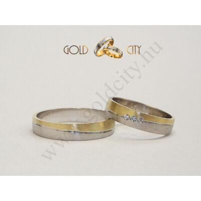 Sárga és fehér arany karikagyűrű kövekkel díszítve.