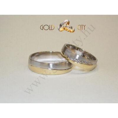 Fényes sárga és matt fehér arany karikagyűrű a nőiben kövekkel a Gold City Ékszer Webáruház kínálatából.