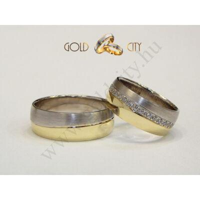 Széles sárga és fehér arany karikagyűrű, a nőiben kövekkel.