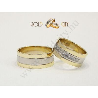Széles sárga és fehér arany karikagyűrű, a nőiben 10 db kővel.
