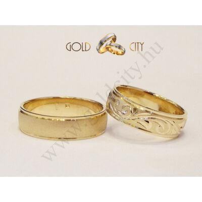 Kézzel vésett 14 karátos sárga aranyból készült karikagyűrű.