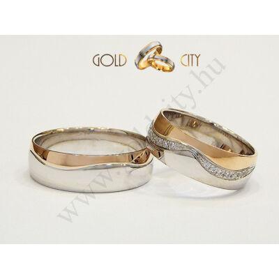 Széles rozé és fehér arany karikagyűrű a nőiben kövekkel.