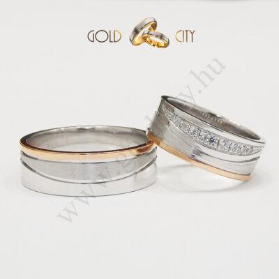 Rozé és fehér arany karikagyűrű a női változatban különleges kőfoglalással.