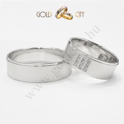 Modern karikagyűrű 14 karátos fehér aranyból, a női gyűrű kövekkel díszítve.