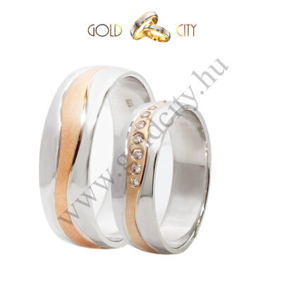 Karikagyűrű 14 karátos rozé és fehér aranyból  kövekkel díszítve.