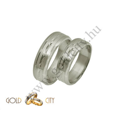 Fehér arany karikagyűrű szolid elegáns mintával. Masszív tartós fazon.