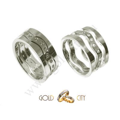 Három különálló karikából álló fehér arany karikagyűrű, a női változat kövekkel díszítve.